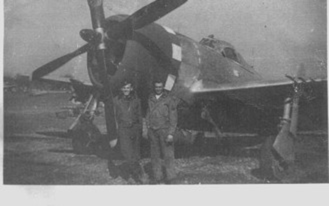 Republic P-47D Thunderbolt fighter-bomber of the 405th Fighter Squadron, flown by 1st Lt. Robert L. Griffith, at left, with an unidentified NCO, likely the crew chief of the aircraft.  The effort to help the Lost Battalion was one of Lt Griffith's early missions, and he was concerned more about the nasty weather than he was about the enemy. Source:  (Courtesy Mr. Jürg Herzig, Stand Where They Fought website, used with permission)