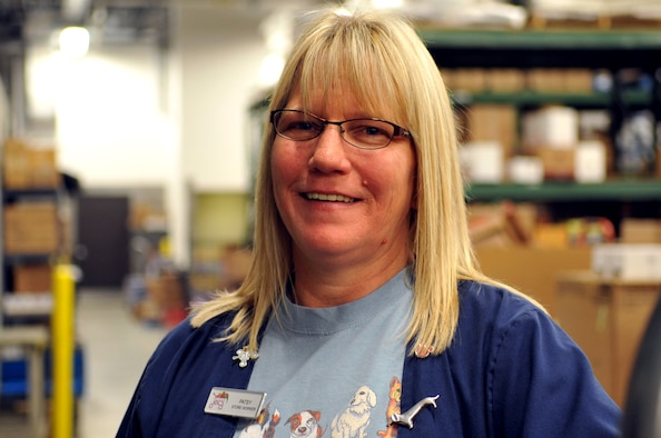 Patsy Nielsen, Grand Forks Air Force Base Commissary store worker, gathers items in the store stockroom for display on the floor here Oct. 29, 2014. Nielsen was named the Grand Forks AFB Warrior of the Week for the fifth week of October 2014. (U.S. Air Force photo/Staff Sgt. Susan L. Davis)