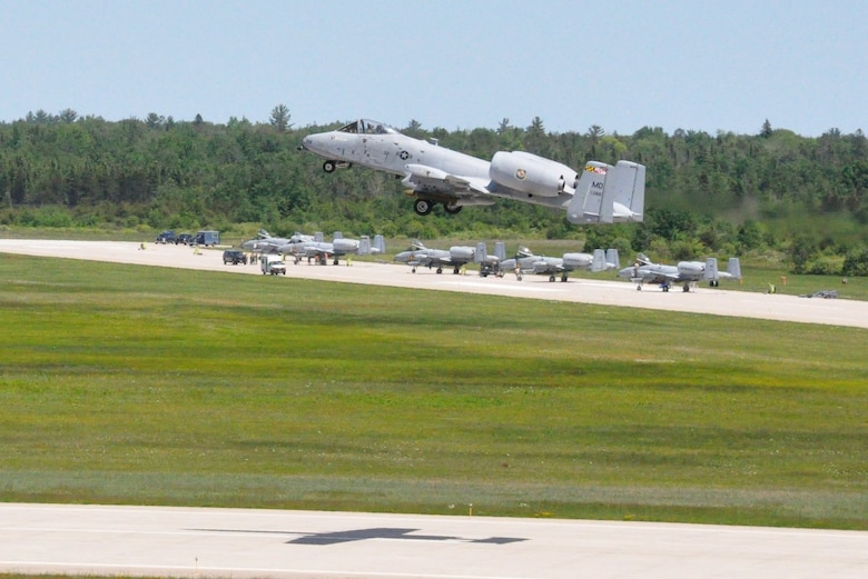 Foreground; MDANG A-10's Taking Off with Live AGM-65's Background; MIANG and 