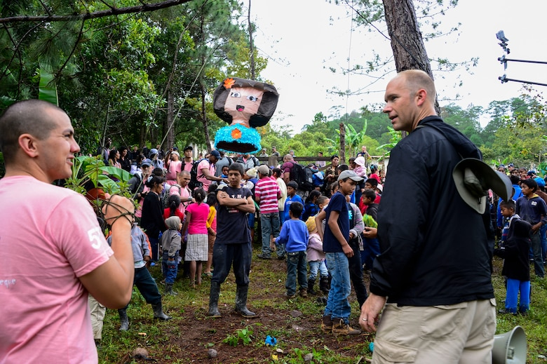 U.S. Army Sgt. Joshua Smith, Joint Task Force-Bravo chaplain assistant, and U.S. Air Force Capt. Samuel McClellan, Joint Task Force-Bravo command chaplain, prepare a piñata for the children in Potrerillos, Siguatepeque, Honduras, Oct. 25, 2014.  As part of the 57th Chapel Hike, more than 130 members assigned to Joint Task Force-Bravo laced up their hiking boots and trekked almost four miles up a mountain to help deliver over 3,500-pounds of donated dry goods to villagers in need. (U.S. Air Force photo/Tech. Sgt. Heather Redman)