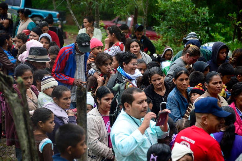 Villagers from Potrerillos, Siguatepeque, Honduras, line up to receive bags of food from members of Joint Task Force-Bravo, Oct. 25, 2014.  As part of the 57th Chapel Hike, more than130 members assigned to Joint Task Force-Bravo laced up their hiking boots and trekked almost four miles up a mountain to help deliver over 3,500-pounds of donated dry goods to villagers in need. (U.S. Air Force photo/Tech. Sgt. Heather Redman)