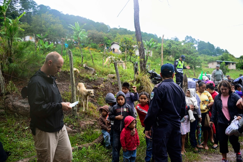 U.S. Air Force Capt. Samuel McClellan, Joint Task Force-Bravo command chaplain, gives the invocation before handing out bags of donated food to villagers in Potrerillos, Siguatepeque, Honduras, Oct. 25, 2014.  As part of the 57th Chapel Hike, more than 130 members assigned to Joint Task Force-Bravo laced up their hiking boots and trekked almost four miles up a mountain to help deliver over 3,500-pounds of donated dry goods to villagers in need. (U.S. Air Force photo/Tech. Sgt. Heather Redman)