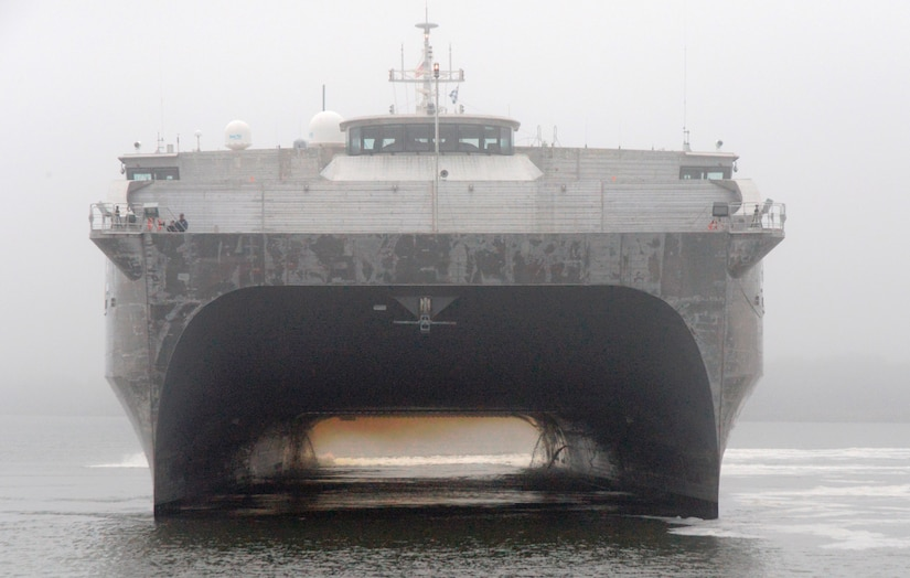 It was a foggy morning as USNS Choctaw County prepares to moor at Wharf ALPHA, Oct. 29, 2014, at Joint Base Charleston, S.C. The Choctaw County is a joint high speed vessel designed for rapid, intra-theater transport of troops and military equipment. The JHSV has a reconfigurable 20,000-square-foot mission bay area that can quickly adapt to support a number of different missions – anything from carrying containerized portable hospitals to support disaster relief to transporting tanks and troops. These ships are capable of transporting approximately 600 tons of military troops, vehicles, supplies and equipment 1,200 nautical miles at an average speed of 35 knots, and are designed to operate in austere ports and waterways, providing added flexibility to U.S. warfighters worldwide.