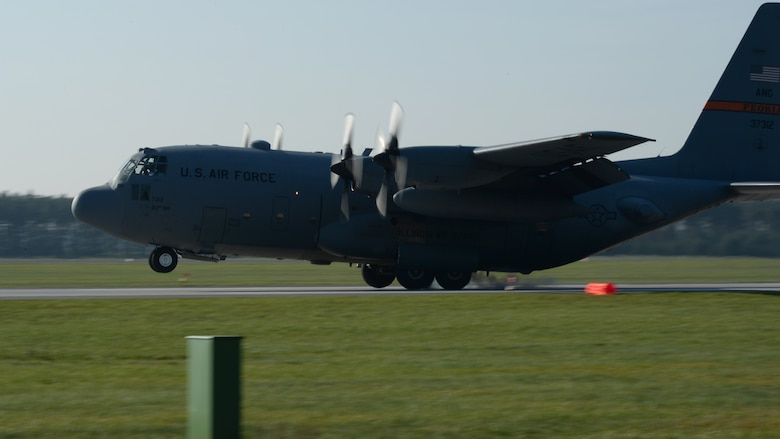 """A U.S. Air Force C-130 Hercules cargo aircraft pilot performs a tactical landing during a """"turkey shoot"""" training mission Oct. 24, 2014, at Powidz Air Base, Poland. Tactical landings consist of touchdowns on short or unimproved runways in tight and remote areas where supplies might be needed. The 182nd Airlift Wing, Illinois Air National Guard, Peoria, Ill., supported rotation 15-1 hosted by the U.S. Air Force Aviation Detachment 1, 52nd Operations Group, Lask Air Base, Poland. The U.S. Air Force's forward presence in Europe allows allies and partners to develop and improve ready air forces capable of maintaining regional security.  (U.S. Air Force photo by Airman 1st Class Dylan Nuckolls/Released)"""