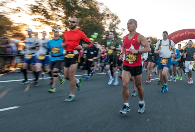 """Civilians and members of the U.S. Armed Forces participate in the 39th Annual Marine Corps Marathon in Washington, D.C., Oct. 27, 2014. Known as """"The People's Marathon,"""" the 26.2 mile race, rated the third largest marathon in the United States, drew 30,000 participants. (U.S. Marine Corps photo by Lance Cpl. Elisha N. Peake/Released)"""