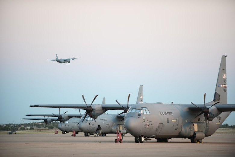 A C-130J Super Hercules departs from Dyess Air Force Base, Texas, Oct. 29, 2014. More than 35 Airmen and two C-130Js from the 317th Airlift Group and 7th Bomb Wing deployed to an air base in Western Europe, where they will provide tactical airlift support for Operation United Assistance. (U.S. Air Force photo by Airman 1st Class Kedesha Pennant)