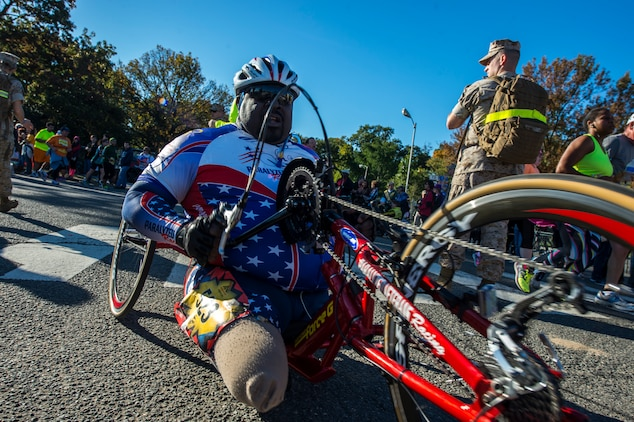 Marines welcome runners as they near the finish line during Sunday's 39th Annual Marine Corps Marathon.