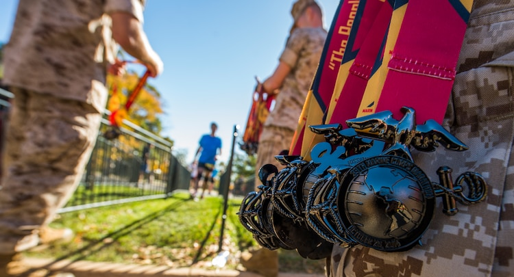Marines handed out medals to runners as they finish Sunday's 39th Annual Marine Corps Marathon.