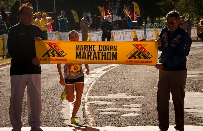 """Civilians and members of the U.S. Armed Forces participate in the 39th Annual Marine Corps Marathon in Washington, D.C., Oct. 27, 2014. Known as """"The People's Marathon,"""" the 26.2 mile race, rated the third largest marathon in the United States, drew 30,000 participants. (U.S. Marine Corps photo by Staff Sgt. Ezekiel R. Kitandwe/Released)"""