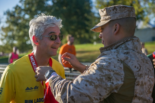 """Civilians and members of the U.S. Armed Forces participate in the 39th Annual Marine Corps Marathon in Washington, D.C., Oct. 27, 2014. Known as """"The People's Marathon,"""" the 26.2 mile race, rated the third largest marathon in the United States, drew 30,000 participants. (U.S. Marine Corps photo by Cpl Ian M. Bush/ Released)"""