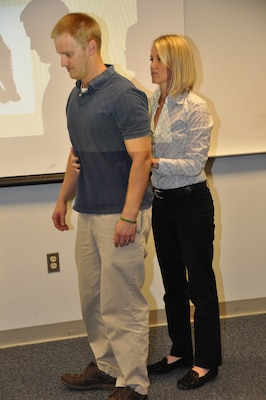 WINCHESTER, Va. - Dr. Melissa Jennings, Winchester Phyiscal Therapy and Sports Medicine, Inc., and employee Joey Behr demonstrate correct posture during the Helath Promotions Committee's brown bag luncheon Oct. 29.