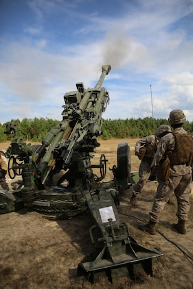 Artillery Marines of Gun 3, Battery A, Ground Combat Element Integrated Task Force, fire a round down range from an M777A2 Lightweight Howitzer during a fire mission at Marine Corps Base Camp Lejeune, North Carolina, Oct. 29, 2014. Marines of Battery A conducted a live-fire artillery shoot, Oct. 28-30, 2014. From October 2014 to July 2015, the GCEITF will conduct individual and collective level skills training in designated ground combat arms occupational specialties in order to facilitate the standards based assessment of the physical performance of Marines in a simulated operating environment performing specific ground combat arms tasks. (U.S. Marine Corps photo by Sgt. Alicia R. Leaders/Released)