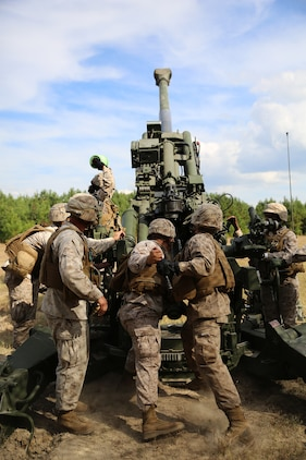 Artillery Marines of Gun 3, Battery A, Ground Combat Element Integrated Task Force, load a round into the chamber of the M777A2 Lightweight Howitzer during a fire mission at Marine Corps Base Camp Lejeune, North Carolina, Oct. 29, 2014. Marines of Battery A conducted a live-fire artillery shoot, Oct. 28-30, 2014. From October 2014 to July 2015, the GCEITF will conduct individual and collective level skills training in designated ground combat arms occupational specialties in order to facilitate the standards based assessment of the physical performance of Marines in a simulated operating environment performing specific ground combat arms tasks. (U.S. Marine Corps photo by Sgt. Alicia R. Leaders/Released)