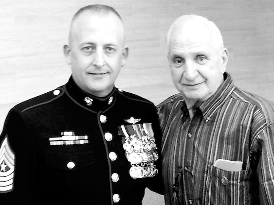 Sgt. Major Justin Lehew, sergeant major, Training and Education Command, and Marine Korean War veteran Sgt. Charles Curcio pose for a picture at the Globe and Laurel restaurant on Saturday.