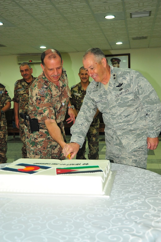 His Royal Highness Prince Feisal bin Al Hussein, of Jordan, and Maj. Gen. H. Michael Edwards, the Adjutant General of Colorado, celebrate the 10th Anniversary of the State Partnership Program relationship between the Colorado National Guard and the Hashemite Kingdom of Jordan at Mwafq Al-Salti Air Base, Jordan, May 14, 2014. (Army National Guard photo by 1st Lt. Skye Robinson)