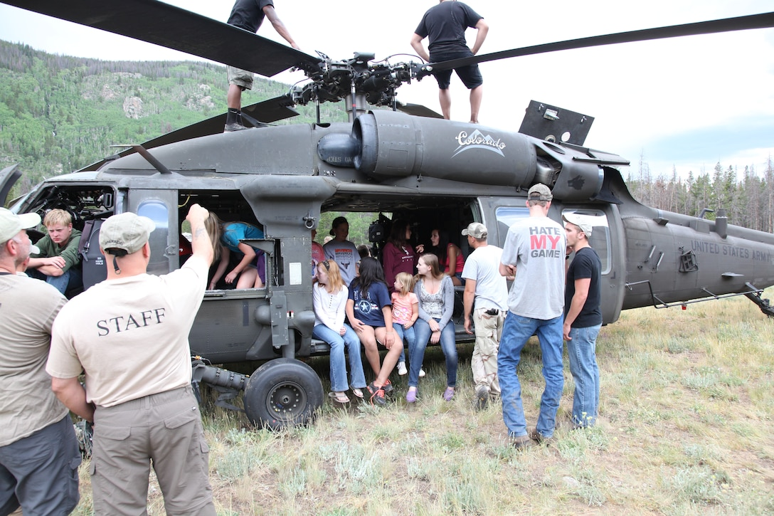 Teens check out a UH-60 Blackhawk owned by the Colorado Army National Guard during the week-long Laramie River Valley Rendezvous program near Ft. Collins, Colo. The kids, who are identified as being high-risk for potential drug use, participate in various games and activities throughout the week and are mentored by members of the Colorado National Guard. (U.S. Air National Guard Photo by Tech. Sgt. B. Kevin Coulter)