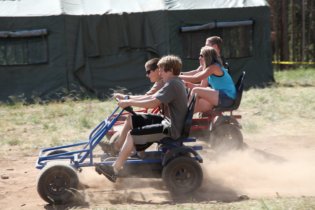 Teens race on pedal carts during the week-long Laramie River Valley Rendezvous program near Ft. Collins, Colo. The kids, who are identified as being high-risk for potential drug use, participate in various games and activities throughout the week and are mentored by members of the Colorado National Guard. (U.S. Air National Guard Photo by Tech. Sgt. B. Kevin Coulter)