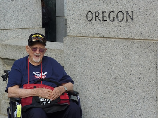 Fred Parish, of La Grande, Oregon, sits beside the granite pillar honoring Oregon and its veterans at the World War II Memorial during a recent Honor Flight trip to Washington, D.C.  Parish is a pioneering member of the Oregon National Guard's 123rd Observation Squadron and served on active duty in the Army Air Corps during World War II.  He served as a medic both stateside and in the China-Burma-India theaters during the war, and attained the rank of Technical Sergeant.