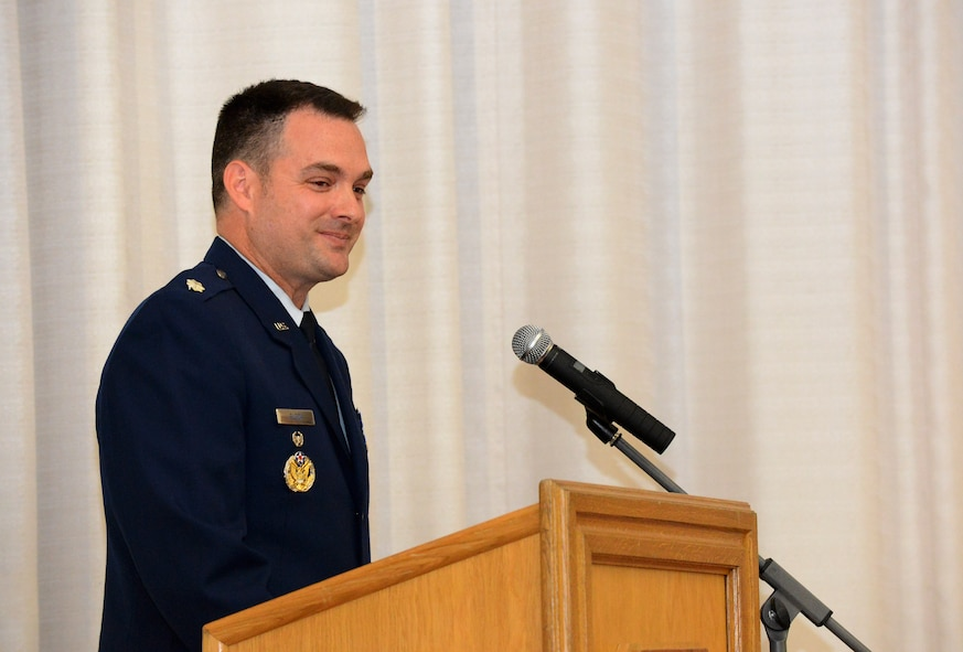 U.S. Air Force Lt. Col. Jay Block, 52nd Munitions Maintenance Group deputy commander, smiles during his speech to the Community College of the Air Force graduates at the base theater on Spangdahlem Air Base, Germany, Oct. 29, 2014. Block was the guest speaker at the ceremony. (U.S. Air Force photo by Airman 1st Class Luke Kitterman/Released)