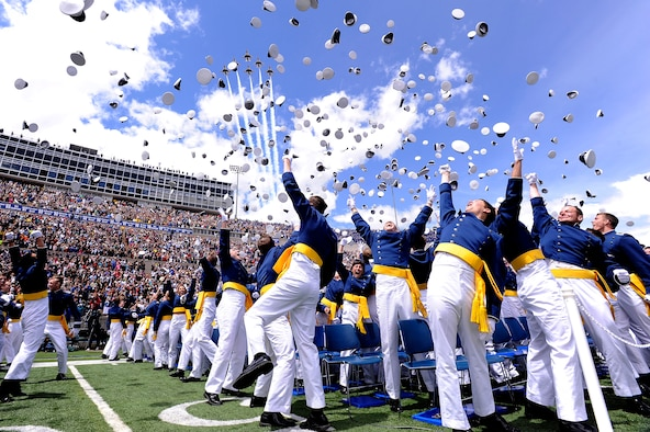 Newly commissioned second lieutenants celebrate at the end of the Air Force Academy's Class of 2011 graduation ceremony May 25, 2011. Flying overhead are F-16 Fighting Falcons with the Thunderbirds. Secretary of the Air Force Michael B. Donley was the guest speaker for the commencement. (U.S. Air Force photo/Mike Kaplan)