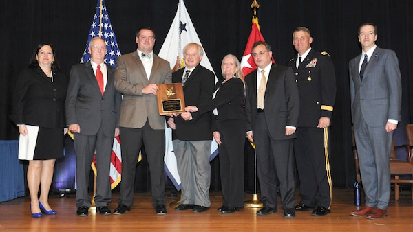 Hon. Katherine Hammack, assistant secretary of the Army for Installations, Energy and Environment; Huntsville Center ESPC team members Michael Norton, chief of the Energy Implementation Branch; Will Irby, program manager for the Energy Savings Performance Contracting Program; Bruce Forsberg, a mechanical engineer for the ESPC team; Margaret Simmons, command counsel; Paul Robinson, Energy Division chief; Lt. Gen. David Halverson, assistant chief of staff for Installation Management; and Mr. Richard Kidd, deputy assistant secretary of the Army for Energy and Sustainability, at the ceremony Oct. 29.