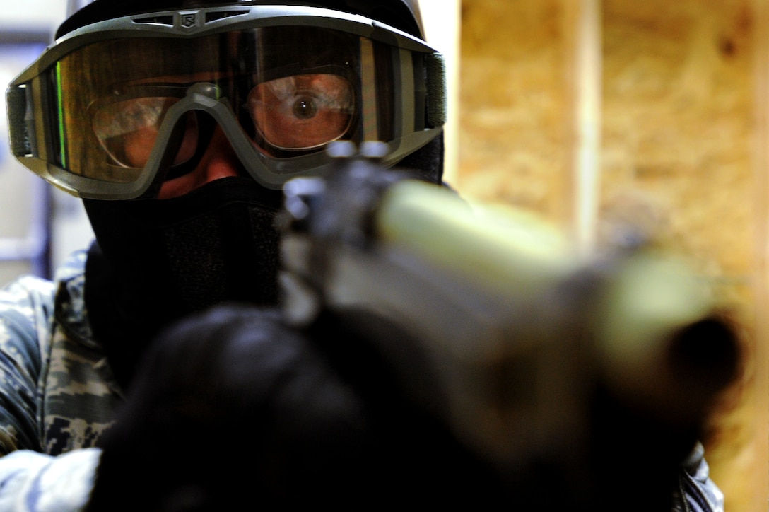 Staff Sgt. Chad Bohr prepares to engage a gunman during an active shooter training session at Shaw Air Force Base, S.C. The 20th Security Forces Squadron schedules active shooter training twice a month to ensure their personnel are fully capable of handling a real active shooter situation. Bohr is a 20th SFS patrolman. (U.S. Air Force photo/Airman 1st Class Michael Cossaboom)