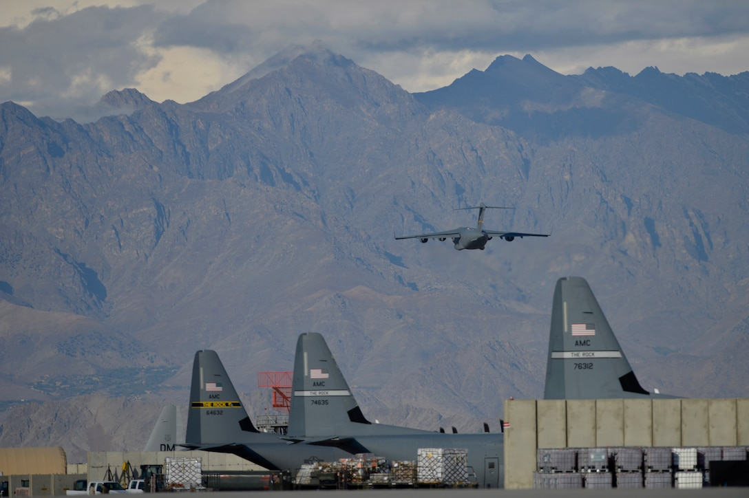 A C-17 Globemaster III takes off into the mountains Oct. 23, 2014, at Bagram Air Field, Afghanistan. Since 2006, the annual airfield traffic count has increased from 143,705 to 333,610 as the support for Operation Enduring Freedom nears its end. (U.S. Air Force photo/Staff Sgt. Evelyn Chavez)