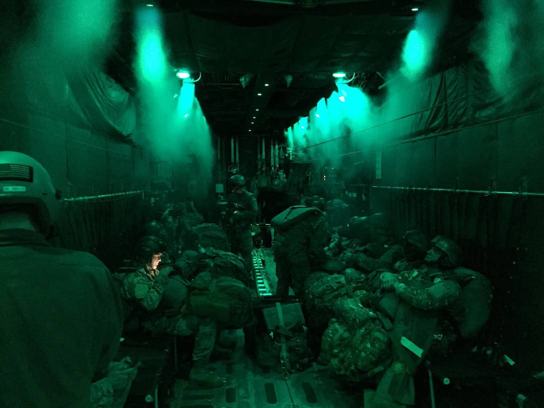 U.S. Army paratroopers standby while approaching their designated drop zone aboard a C-130H Hercules aircraft assigned to the 103rd Airlift Wing Oct. 8, 2014, in the skies above Hunter Army Airfield, Ga. This is the second opportunity for the Flying Yankees to successfully aid in the preparation and execution of paratrooper air drops during joint Army air transportation training missions with their newly-assigned aircraft. (Photo courtesy of Tech. Sgt. Tufic Paone)