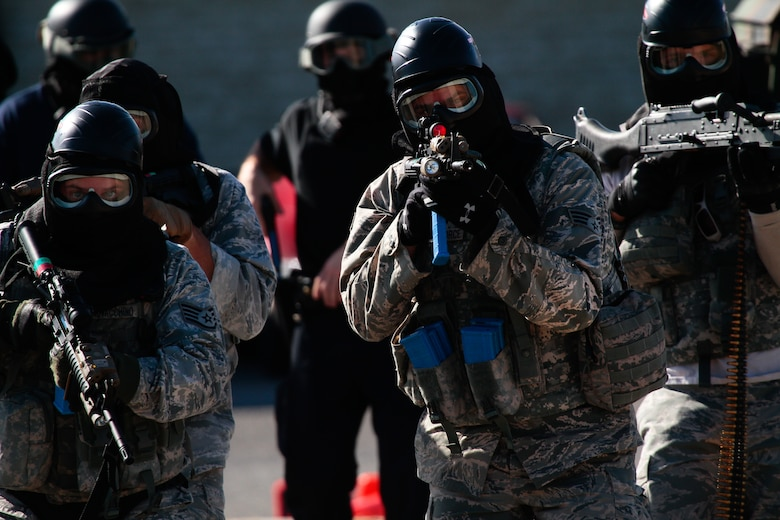 Airmen from the New Jersey Air National Guard's 177th Security Forces Squadron and local law enforcement officers move toward the sound of gunfire Oct. 24, 2014, during an active shooter exercise at Atlantic City Air National Guard Base, N.J. The 177th SFS hosted the training event, which was the culmination of active shooter and tactical combat casualty care classes attended by security forces Airmen as well as police officers from the local community. (U.S. Air National Guard photo/Tech. Sgt. Matt Hecht)