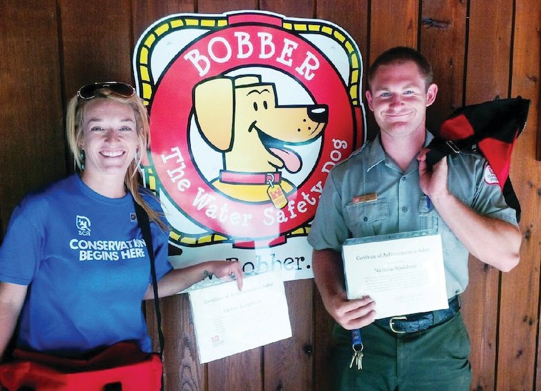 Alum Creek Lake employees Melissa Longshore, SCA intern (left), and Nicholas Spalsbury, Water Safety Ranger, each received employee safety awards for their contributions to water and boating safety programs during the 2014 recreation season. Over 15,000 direct contacts have been made through education programs, fair and event exhibits, parades, and visitor assistance patrols. (Photo by Robert J. Wattenschaidt)