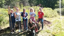 A Connecticut Girl Scout Troop assists Park Ranger Marissa Wright in improving the Black Rock Lake butterfly garde during the National Public Lands Day Event, Sept. 14, 2014.