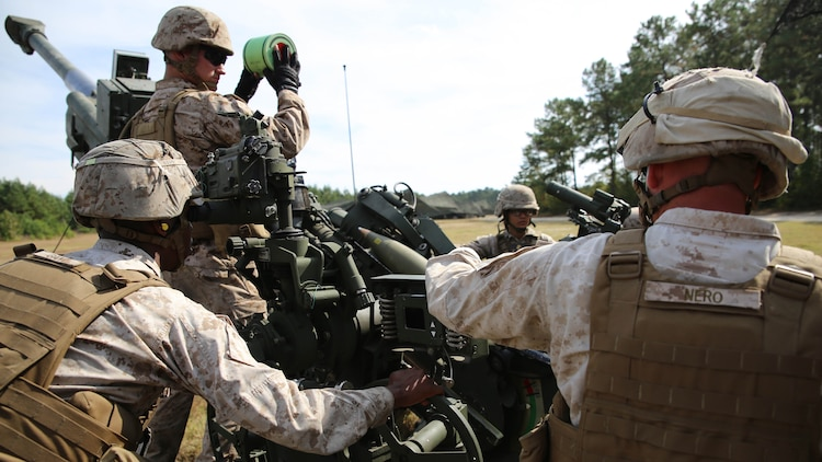 Artillery Marines with Gun 3, Battery A, Ground Combat Element Integrated Task Force, prepare to send a round down range during a fire mission at Marine Corps Base Camp Lejeune, Oct. 29, 2014. Marines of Battery A conducted a live-fire artillery shoot, Oct. 28-30, 2014. From October 2014 to July 2015, the GCEITF will conduct individual and collective level skills training in designated ground combat arms occupational specialties in order to facilitate the standards based assessment of the physical performance of Marines in a simulated operating environment performing specific ground combat arms tasks.