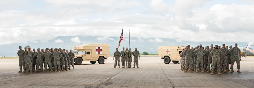 Two U.S. Army companies stand in formation for Joint Task Force-Bravo's Medical Element Transfer of Authority Ceremony between the 228th Combat Support Hospital and the 94th Combat Support Hospital on Soto Cano Air Base, Honduras, Oct. 31, 2014.  Over the past two weeks the 228th CSH prepared the 94th CSH to take over their U.S. Southern Command mission.  The JTF-B MEDEL is the only forward deployed medical asset with and enduring presence within SOUTHCOM.  MEDEL provides medical support to DoD beneficiaries in garrison at Soto Cano AB, as well as supporting SOUTHCOM's humanitarian assistance and disaster relief efforts.  (U.S. Air Force photo/Tech. Sgt. Heather Redman)