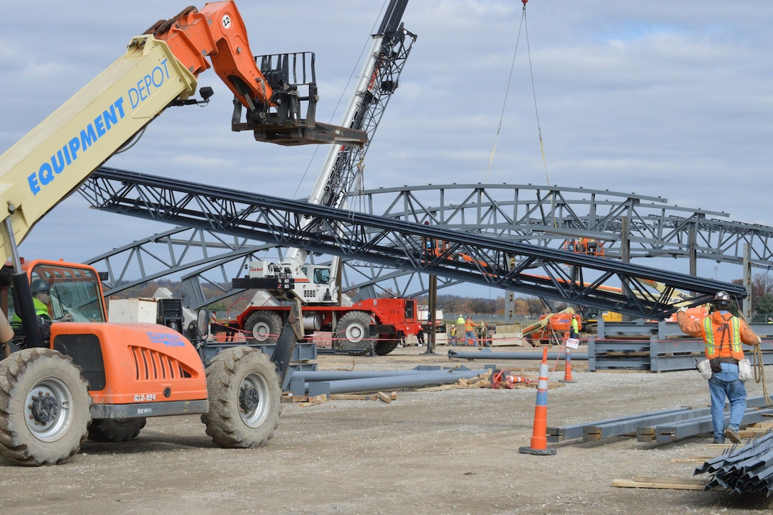 DAYTON, Ohio -- Construction crews work on erecting the steel truss for the new building. The 224,000 square foot building, which is scheduled to open to the public in 2016, is being privately financed by the Air Force Museum Foundation, a non-profit organization chartered to assist in the development and expansion of the museum's facilities. (U.S. Air Force photo)