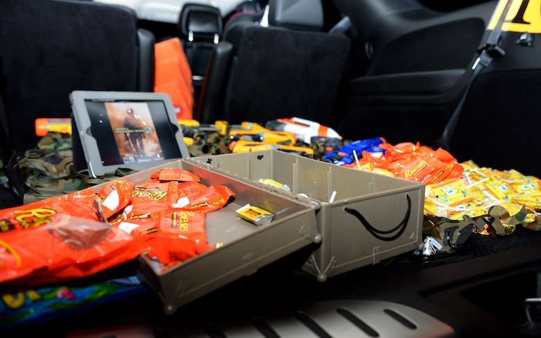 "Assorted candy lies inside a car trunk for ""Trunk-or-Treat"" during Family Fright Night at the Club Eifel parking lot on Spangdahlem Air Base, Germany, Oct. 30, 2014. More than 10 vehicles and 50 volunteers participated in the ""Trunk-or-Treat"" event. (U.S. Air Force photo by Airman 1st Class Luke Kitterman/Released)"