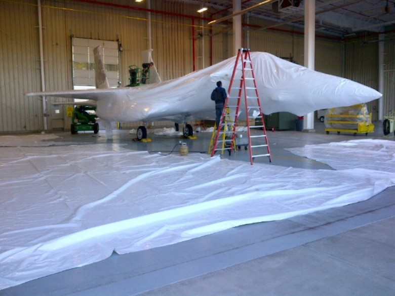 Atlantic Shrink Wrapping Inc. shrink wraps an F-15A Eagle for storage while a permanent location for this static display is selected and built. (U.S. Air National Guard Photo by Chief Master Sgt. Wayne Brown/Released)