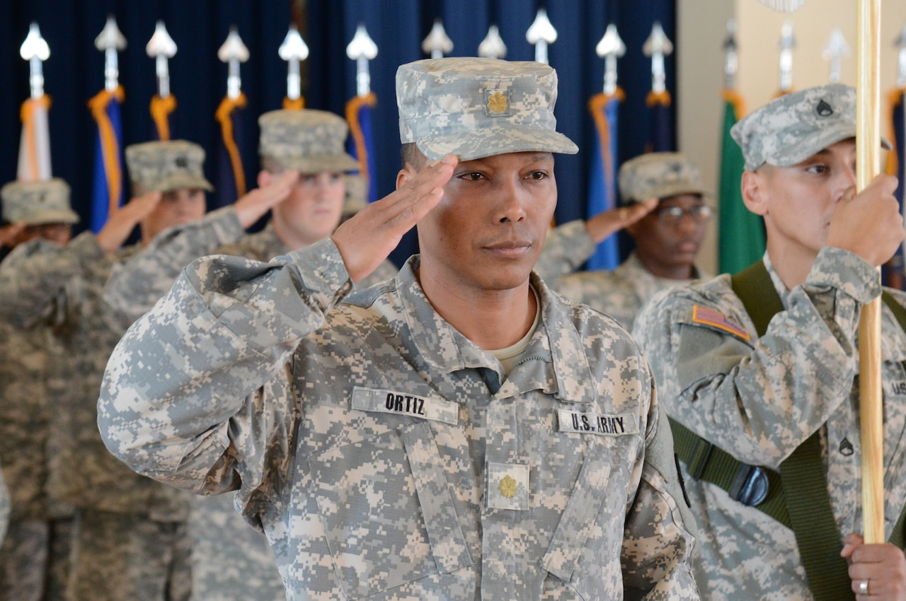 Army Maj. Felix Ortiz, executive officer of the 1st Area Medical Laboratory, salutes during the 1st AML's Oct. 27, 2014, casing ceremony at Aberdeen Proving Ground, Md. The AML is deploying to Liberia to set up laboratories in support of Operation United Assistance, the U.S. response to the Ebola outbreak in West Africa. U.S. Army photo by Sean Kief