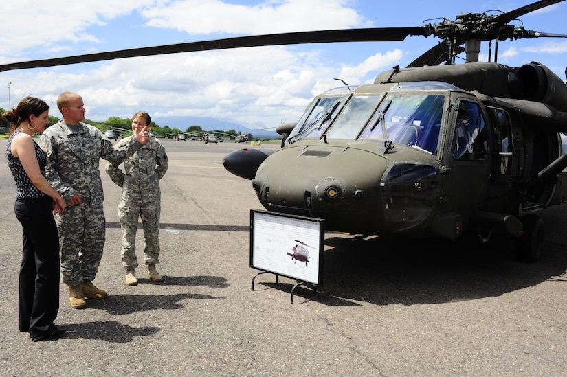 U.S. Army Staff Sgt. Kelly Steckler (left) and 1st Lt. Lauren Rattan, both from the 1-228th Aviation Regiment, explain the mission capabilities of the UH-60 Black Hawk Helicopter to Dr. Rebecca Chavez, the Deputy Assistant Secretary of Defense for Western Hemisphere Affairs, Aug. 28 during a command tour of Joint Task Force-Bravo at Soto Cano Air Base, Honduras.  (Photo by Martin Chahin)