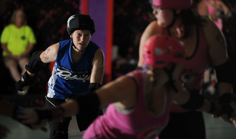 Lt. Col. Melanie Friedman gets ready to jam her opponent during a roller derby bout August 9, 2014 in Montgomery, Ala. The jammers job is to score points by lapping around or through the blockers. The blockers must stop the opposing team's jammer from lapping, and help their own team's jammer score points. Friedman is the deputy director of intelligence at the Curtis E. Lemay Center for Doctrine Development and Education. (U.S. Air Force photo/Staff Sgt. Natasha Stannard)