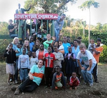 Children of Samaritan Village and their new friends from Yuba City, California, pose for one final shot after construction of new playground equipment at the orphanage near Arusha, Tanzania. The Yuba City team spent two weeks in Tanzania in August 2014, improving orphanage facilities and meeting the kids.