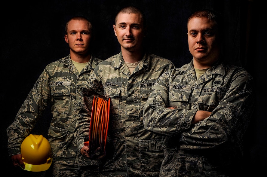 (from left to right) Senior Airman Josh Love, 5th Civil Engineer Squadron water and fuels maintenance journeyman, Senior Airman Vince Betzel, 91st Missile Maintenance Squadron missile communication team chief, and Senior Airman Scott Allen, 5th Maintenance Squadron fuel systems repair technician, pose for a photograph on Minot Air Force Base, N.D., Aug. 25, 2014. All three are currently attending Airman Leadership School in preparation to become Staff Sergeants and supervisors. (U.S. Air Force photo/Senior Airman Stephanie Morris)