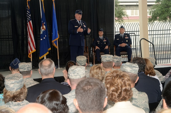 Lt. Gen. Thomas W. Travis, Surgeon General of the Air Force, addresses attendees at the Air Force Medical Operations Agency change of command ceremony as Brig. Gen. Sean L. Murphy, outgoing AFMOA commander, and Col. Lee A. Payne, incoming AFMOA commander, look on at Joint Base San Antonio-Lackland Kelly Field Annex Aug. 29, 2014. AFMOA oversees the execution of the Air Force Surgeon General policies supporting Air Force expeditionary capabilities, healthcare operations and national security strategy. Col. Payne will be responsible for leading consultative support of over 43,000 personnel, 75 Medical Treatment Facilities with a $6.1 billion budget. (U.S. Air Force Photo by Johnny Saldivar)