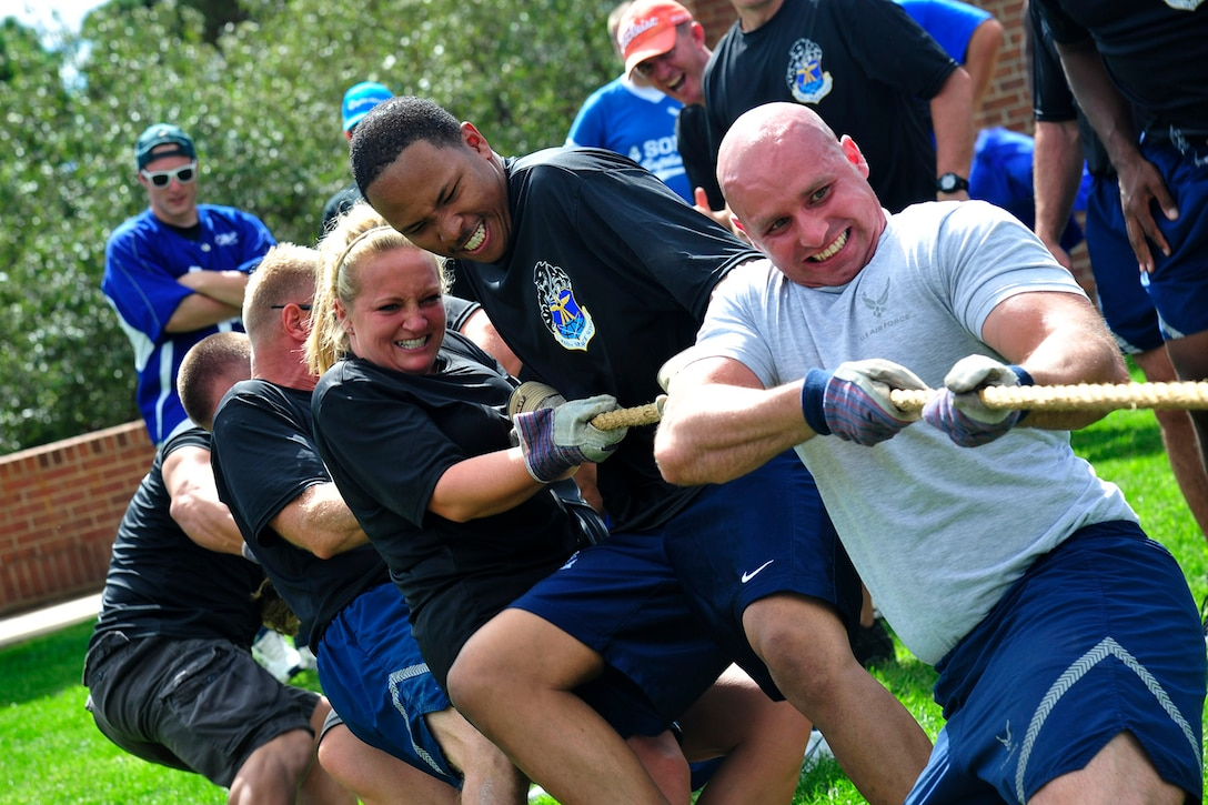 PETERSON AIR FORCE BASE, Colo. -- Airmen from Buckley Air Force Base give their all in a tug-of-war match during the first-ever Tri-Wing Sports Challenge Aug. 27 hosted by Peterson Air Force Base. The Tri-Wing Sports Challenge was an opportunity for Airmen from Buckley AFB, Peterson AFB and Schriever AFB to strengthen the bonds of camaraderie in an environment outside of the workplace. (U.S. Air Force Photo/Robb Lingley)