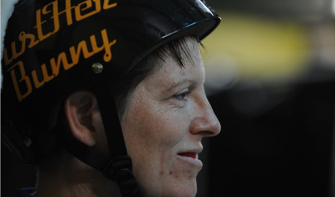 Lt. Col. Melanie Friedman looks at the skating rink moments before the Capitol City Rollin' Rebels and Mobile Derby Darlins' roller derby  bout Aug. 9, 2014. Friedman is the deputy director of intelligence at the Curtis E. Lemay Center for Doctrine, Development and Education at Maxwell Air Force Base. (U.S. Air Force photo by Staff Sgt. Natasha Stannard)