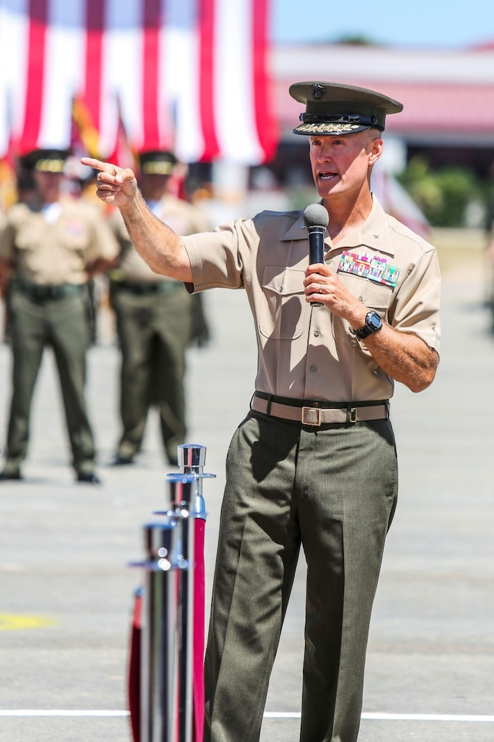 Brigadier Gen. Carl E. Mundy III, the former commanding general of 1st Marine Expeditionary Brigade, speaks about his time with the unit during the 1st MEB change of command ceremony aboard Camp Pendleton, Calif., Aug. 29, 2014. Mundy has served as the commanding general of 1st MEB since July 2013. (U.S. Marine Corps photo by Lance Cpl. Carson Gramley)