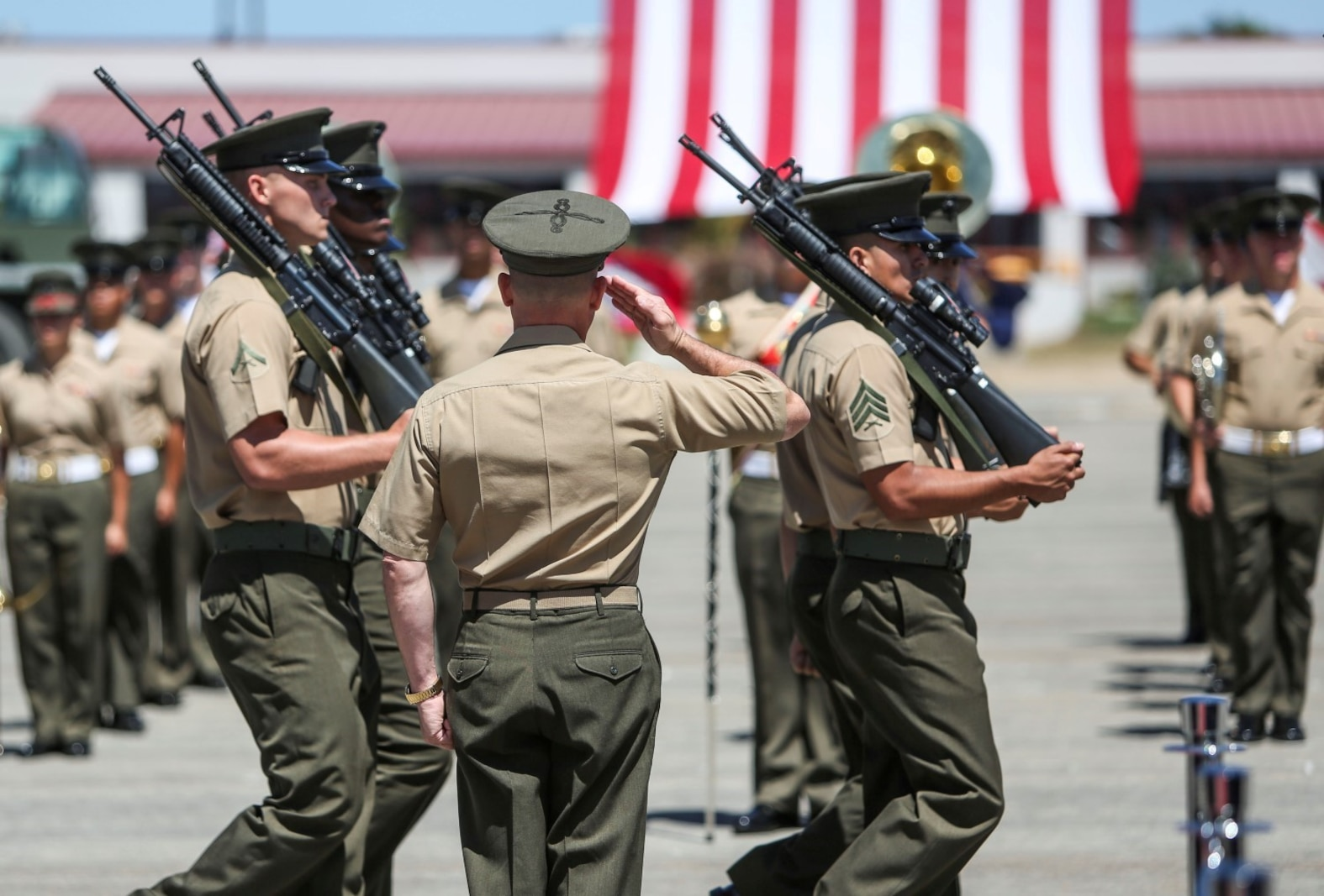 Brigadier Gen. Joaquin F. Malavet, the commanding general of 1st Marine Expeditionary Brigade, inspects Marines passing in review during the 1st MEB change of command ceremony aboard Camp Pendleton, Calif., Aug. 29, 2014. Malavet was previously assigned as the principal director, South and Southeast Asia for the Office of the Secretary of Defense-Policy at Washington, D.C. (U.S. Marine Corps photo by Lance Cpl. Carson Gramley)