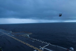 "A CH-46E Sea Knight helicopter with Marine Medium Helicopter Squadron 364 approaches the flight deck of the future amphibious assault ship USS America (LHA 6) preparing to land, Aug. 24, 2014. Four helicopters with the squadron arrived aboard America ending the exercise Partnership of the Americas 2014. POA was based on a simulated humanitarian assistance and disaster relief scenario in Chile. Multiple nations came together to plan and execute a multi-lateral exercise in response to the HA/DR scenario. Exercises like POA allow the U.S. and our partners in the region to respond to and address transnational and global challenges. America is currently transiting through the U.S. Southern Command's area of responsibility on her maiden transit ""America Visits the Americas."" (U.S. Marine Corps Photo by Cpl. Donald Holbert/ Released)"