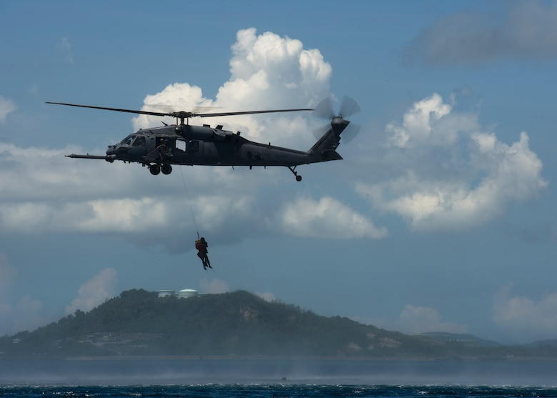 "A U.S. Air Force HH-60 Pave Hawk from the 31st Rescue Squadron participates in a ""downed pilot"" exercise, Kadena Air Base, Japan, Aug 26, 2014. The 31st RS uses various fixed- and rotary-wing insertion and extraction assets providing combat and humanitarian search, rescue and medical assistance in all environments. (U.S. Air Force photo by Senior Airman Justyn M. Freeman/Released)"