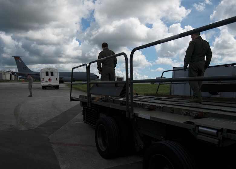 "The U.S. Air Force 18th Aeromedical Evacuation Squadron prepares an Atlas K Loader to receive a ""patient"" during a medical exercise, Kadena Air Base, Japan, Aug 26, 2014. The 18th Aeromedical Evacuation Squadron maintains a forward presence and supports medical contingencies in the Pacific including the only neonatal air facility in the region. Their area of operations is the largest in the military, reaching from the Horn of Africa to Alaska. (U.S. Air Force photo by Senior Airman Justyn M. Freeman/Released)"