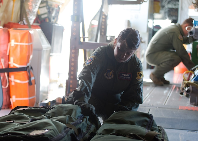 U.S. Air Force Staff Sgt. Holly Mason, 18th Aeromedical Evacuation Squadron, lowers a stretcher placeholder on a KC-135 Stratotanker during a medical exercise, Kadena Air Base, Japan, Aug 26, 2014. The 18th Aeromedical Evacuation Squadron maintains a forward presence and supports medical contingencies in the Pacific including the only neonatal air facility in the region. Their area of operations is the largest in the military, reaching from the Horn of Africa to Alaska. (U.S. Air Force photo by Senior Airman Justyn M. Freeman/Released)